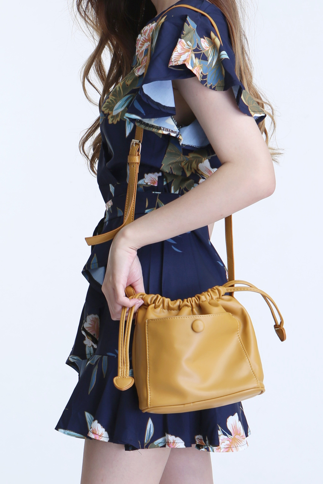 BACKORDER - FLODY  DRAWSTRING SLING BAG IN MUSTARD YELLOW